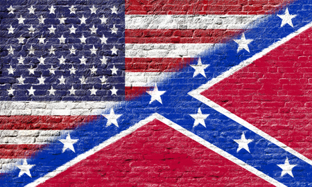 Confederate flag with United states flag on Brick wall