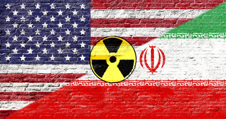 nuclear icon: United states and Iran - National flags on Brick wall with nuclear icon