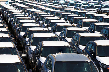 new car lot: Rows of brand new cars Stock Photo