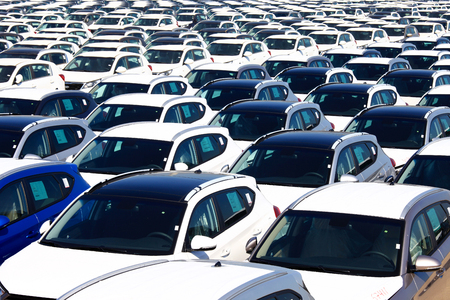 new car lot: Rows of brand new cars Editorial