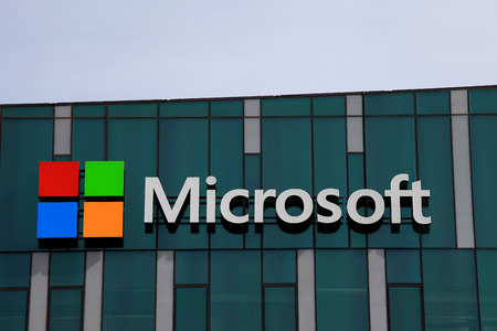 Microsoft logo and emblem. Microsoft is an international corporation that develops, supports and sells computer software and services worldwide. Editorial