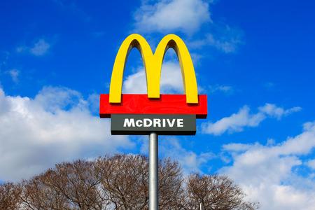 macdonald: Classic McDonalds sign with blue sky.