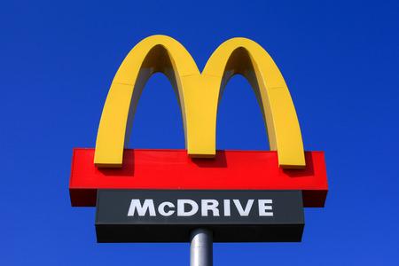 mcdonalds: Classic McDonalds sign with blue sky.
