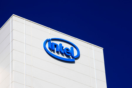 intel: Intel logo on a building, Intel is one of the worlds largest and highest valued semiconductor chip makers, based on revenue.