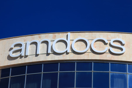 service providers: Amdocs logo on a building.  Amdocs is a software and services to more than 250 communications, media and entertainment service providers in more than 90 countries Editorial