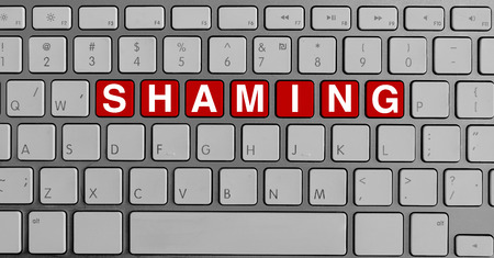 shaming: Keyboard with red buttons and shaming text