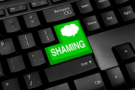 shaming: Keyboard with green button and shaming text Stock Photo