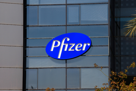 Pfizer logo on a building. Pfizer develops and produces medicines and vaccines for a wide range of medical disciplines Editöryel