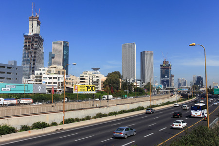 azrieli: Tel Avivs Hashalom central junction with traffic and the 3 Azrieli buildings, a known landmark in central Tel Aviv