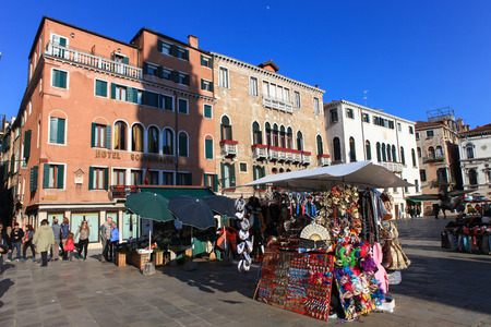 the merchant of venice: Typical Piazza or Campo in the heart of venice, with shops, typical venetian architecture and tourists passing by