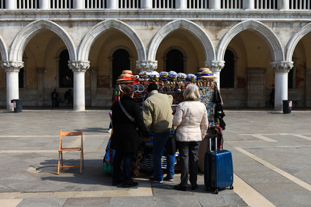 souvenir traditional: Typical souvenir stand in Piazza San Marco, offering a wide variety of traditional Venetian symbolic goods