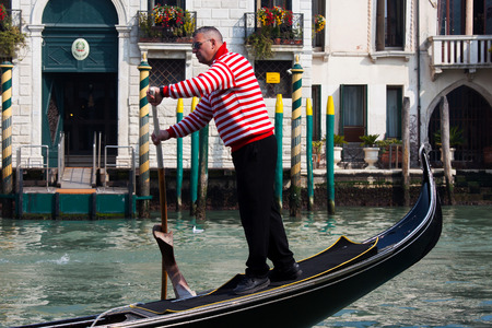 gondolier: Gondolier and Gondola at Venice grand canal. The Gondola is a traditional, flat-bottomed Venetian rowing boat, well suited to the conditions of the Venetian lagoon