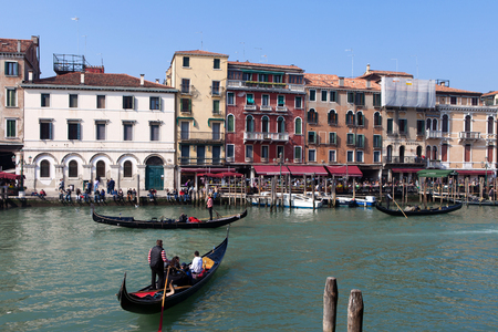 venice canal: Traditional Gondola on a Venice canal Editorial