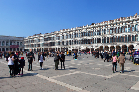 locals: Locals and tourist at Piazza San Marco, the principal public square of Venice, Italy, Editorial