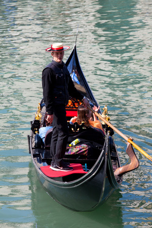 gondolier: Gondolier and Gondola at Venice grand canal