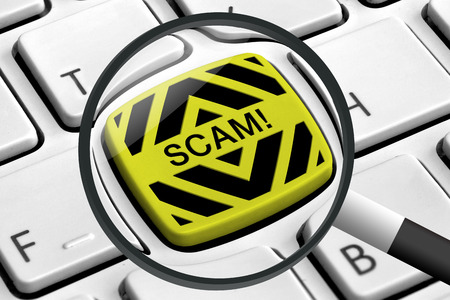 web scam: Computer keyboard with yellow scam buttons and magnifying glass Stock Photo