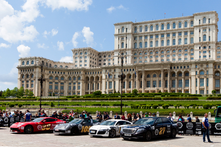 gumball: Super cars of the exclusive Gumboil 3000 parked in front of the Romanian Parliament. Gumball is an international celebrity rally which takes place on public roads.