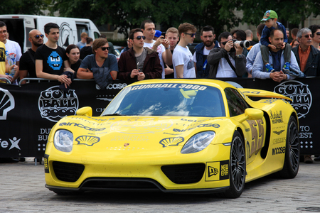 gumball: Super cars of the exclusive Gumboil 3000 parked in front of the Romanian Parliament. Gumball is an international celebrity rally which takes place on public roads
