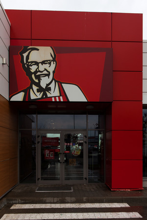 specializes: KFC sign, Kentucky Fried Chicken (KFC) is a fast food restaurant chain that specializes in fried chicken, It is the worlds second largest restaurant chain. Editorial