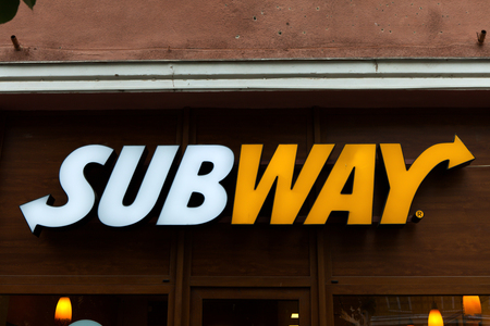 primarily: Subway logo. Subway is an American fast food restaurant franchise that primarily sells submarine sandwiches (subs) and salads.