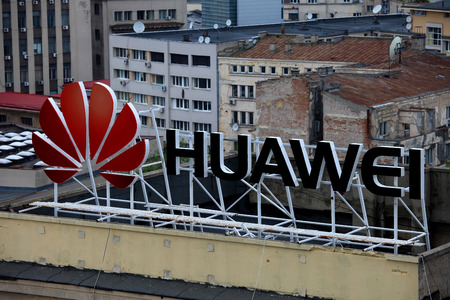 telecommunications equipment: Huawei sign on a building, Huawei Technologies Co. is a Chinese multinational networking and telecommunications equipment and services . Editorial