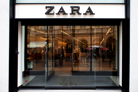 retailer: Zara logo and store front. Zara is a Spanish clothing and accessories retailer based in Arteixo, Galicia. It is the worlds largest apparel retailer.