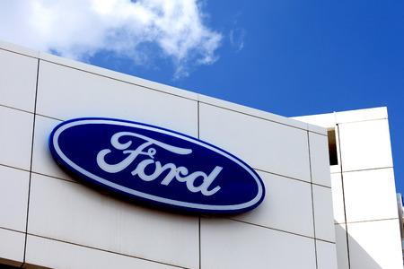 dealerships: Ford logo on a dealerships building. Editorial