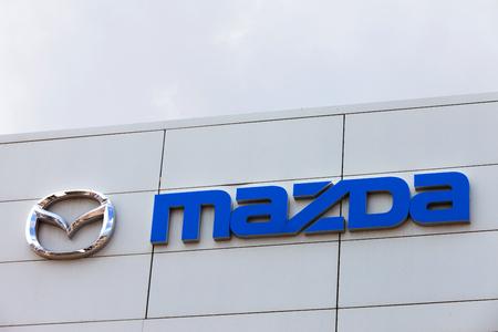 dealerships: Mazda logo on a dealerships building