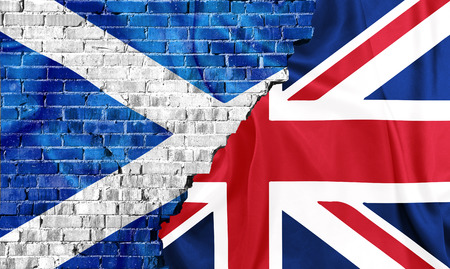 withdrawal: United Kingdom and Scotland flags combined on a broken brick wall