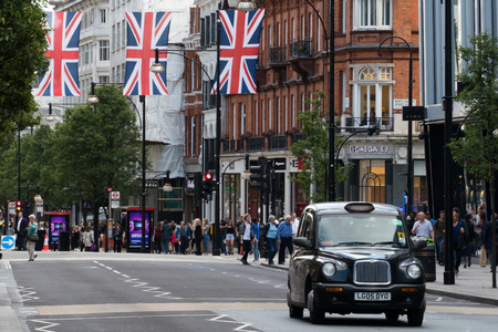 bond street: Typical black London cab in central London