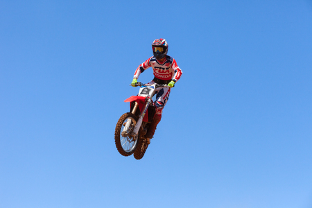 supercross: Motocross rider and bike clearing a tabletop jump during the final heat of the race