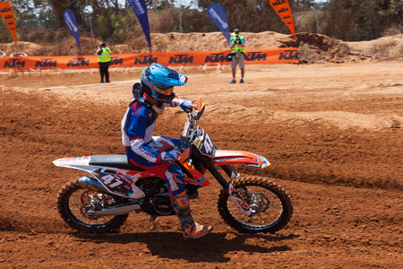 supercross: Motocross rider take on a tight but fast turn during the final heat of the race.