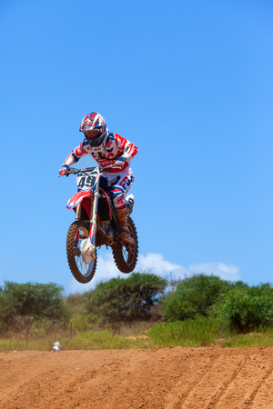 supercross: Motocross rider and bike clearing a tabletop jump during the final heat of the race. Editorial