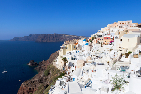 domes: White houses and blue domes of Oia, Santorini. Stock Photo