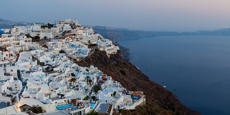 White houses and blue domes of Fira, Santorini.