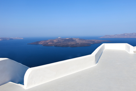 walking paths: Santorinis famous Volcano with the white curves of Santorinis walking paths Stock Photo