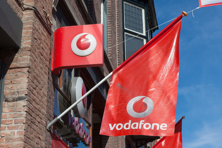 headquartered: Vodafone logo. Vodafone Group is a British telecommunications company headquartered in London and with its registered office in Newbury, Berkshire.