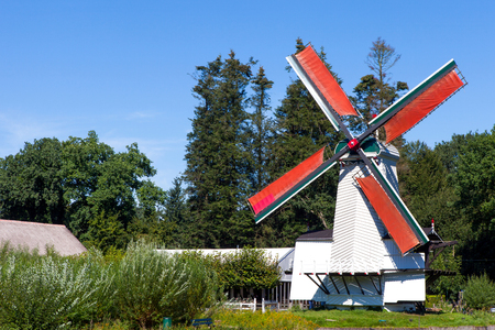 Classic Dutch windmills in nature with blue sky in the background Stock Photo