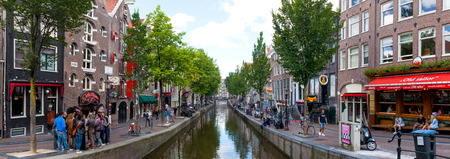 red light district: Panoramic view of the Red light district of Amsterdam and the main street and canal.