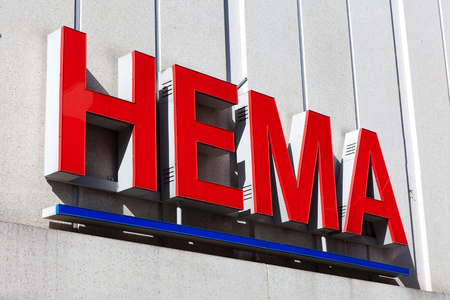 Hema sign.Hema is a Dutch discount retail chain that started life as a dimestore. Hema has been owned by the British investment firm Lion Capital. Banco de Imagens - 62303638