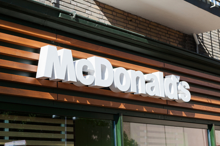 macdonald: McDonalds sign, McDonalds is the worlds largest chain of hamburger fast food restaurants, serving around 68 million customers daily in 119 countries