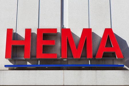 Hema sign.Hema is a Dutch discount retail chain that started life as a dimestore. Hema has been owned by the British investment firm Lion Capital. Banco de Imagens - 62303681