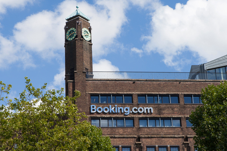Booking.com logo on a building in Amsterdam. Booking.com is an online accommodation booking website started as a small start-up based in Amsterdam.