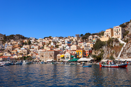 Symi island - Colorful houses and small boats at the heart of the village Stock Photo
