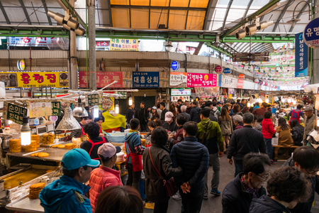 Locals and tourists at Noryangjin Fisheries Wholesale Market, an extensive farmers fish market in the neighborhood of Noryangjin-dong in Dongjak-gu, Seoul. Editorial