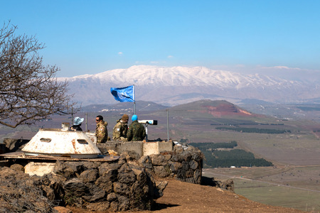 U.N peace keeping soldiers observing the Israel - Syria  border from the Israeli side.