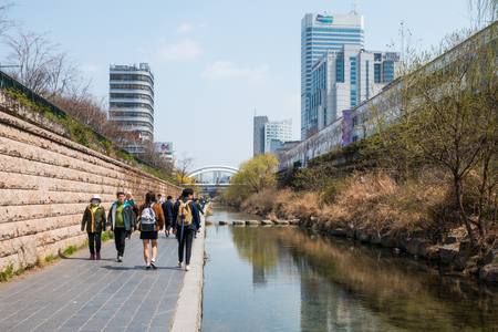 Locals and tourists enjoy a walk at Cheonggye Stream near Dongdaemun Market. A modern public recreation space in downtown Seoul, South Korea. Editorial