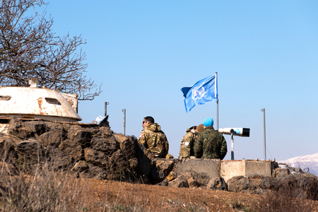 syria peace: U.N peace keeping soldiers observing the Israel - Syria  border from the Israeli side.