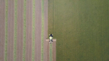 Combine harvester in a green field