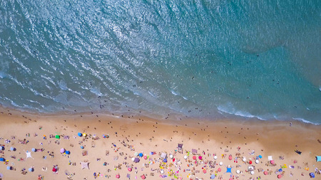 Tropical beach with colorful umbrellas - Top down aerial view Banco de Imagens